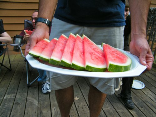 Bro. Antczak offers watermelon.